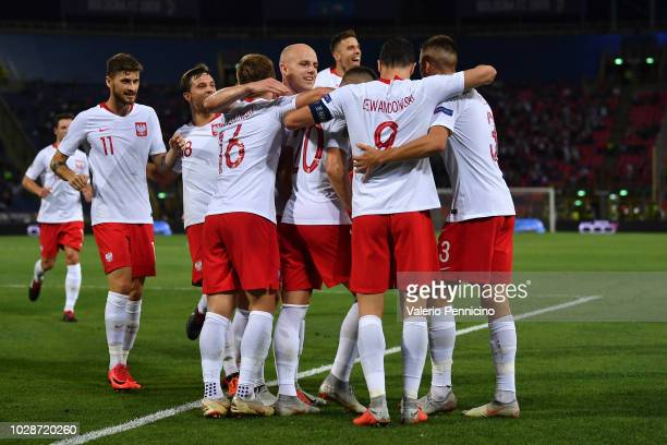 Piotr Zielinski of Poland celebrates with teammates after scoring the opening goal during the UEFA Nations League A group three match between Italy...
