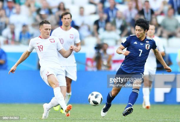 Piotr Zielinski of Poland competes with Gaku Shibasaki of Japan during the 2018 FIFA World Cup Russia group H match between Japan and Poland at...