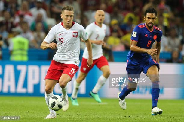 Piotr Zielinski of Poland vies Abel Aguilar of Colombia during the Russia 2018 World Cup Group H football match between Poland and Colombia at the...