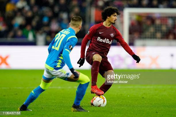 Piotr Zielinski of SSC Napoli and Andre Ramalho of Salzburg during the UEFA Europa League Round of 16 match between FC Salzburg and SSC Napoli at Red...