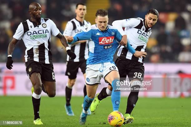 Piotr Zielinski of SSC Napoli competes for the ball with Rolando Mandragora of Udinese Calcio during the Serie A match between Udinese Calcio and SSC...