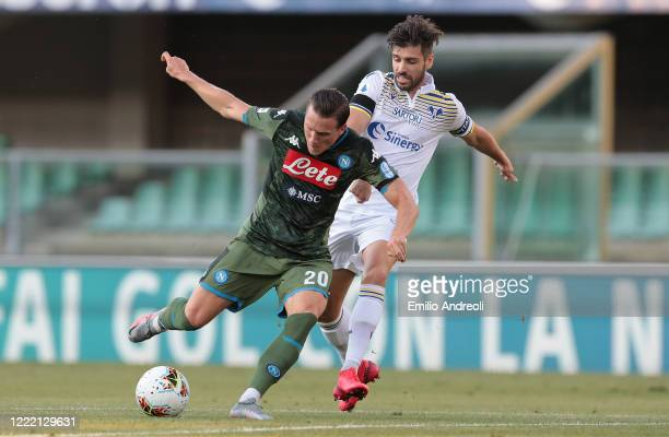 Piotr Zielinski of SSC Napoli is challenged by Miguel Veloso of Hellas Verona during the Serie A match between Hellas Verona and SSC Napoli at Stadio...