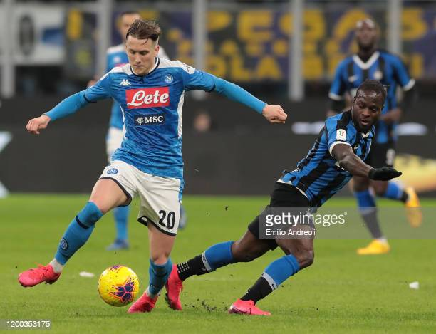 Piotr Zielinski of SSC Napoli is challenged by Victor Moses of FC Internazionale during the Coppa Italia Semi Final match between FC Internazionale...