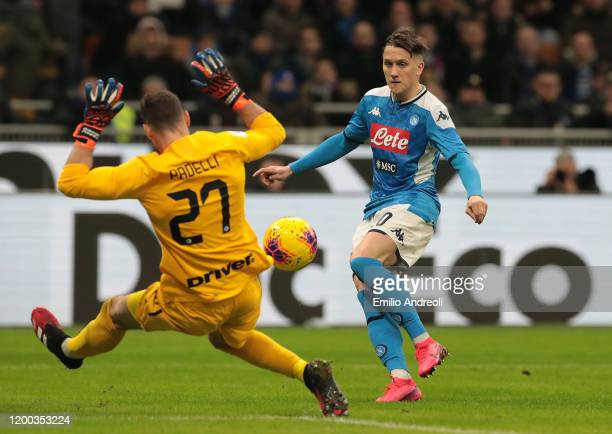 Piotr Zielinski of SSC Napoli kicks the ball and Daniele Padelli of FC Internazionale saves during the Coppa Italia Semi Final match between FC...