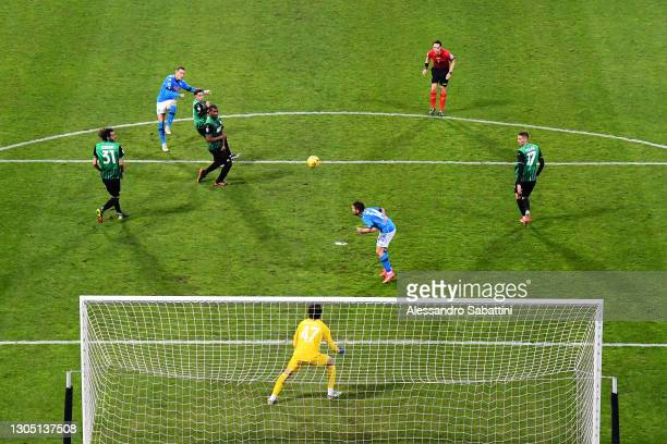 Piotr Zielinski of SSC Napoli scores their sides first goal past Andrea Consigli of U.S. Sassuolo Calcio during the Serie A match between US Sassuolo...