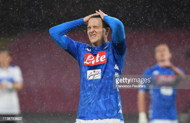 Piotr Zielinski of SSC Napoli stands disappointed during the Serie A match between SSC Napoli and Atalanta BC at Stadio San Paolo on April 22 2019 in...