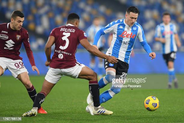 Piotr Zielinski of S.S.C. Napoli takes on Gleison Bremer of Torino F.C. During the Serie A match between SSC Napoli and Torino FC at Stadio Diego...