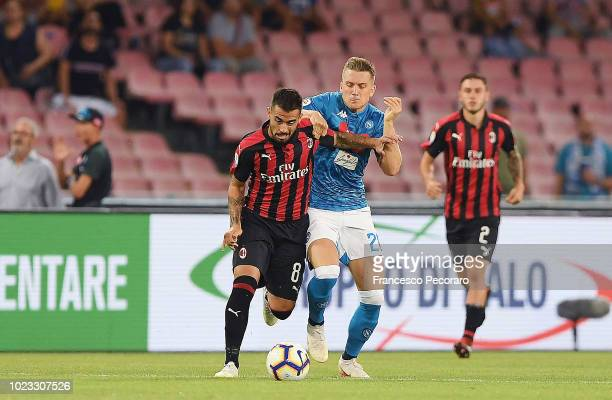 Piotr Zielinski of SSC Napoli vies Suso of AC Milan during the serie A match between SSC Napoli and AC Milan at Stadio San Paolo on August 25 2018 in...