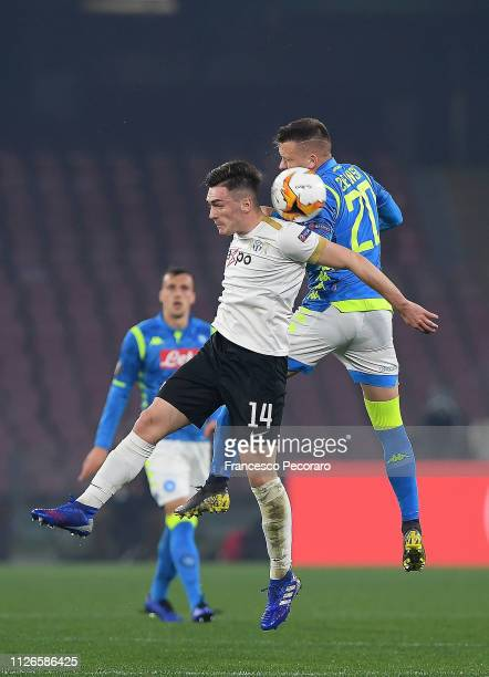 Piotr Zielinski of SSC Napoli vies Toni Domgjoni of FC Zurich during the UEFA Europa League Round of 32 Second Leg match between SSC Napoli v FC...