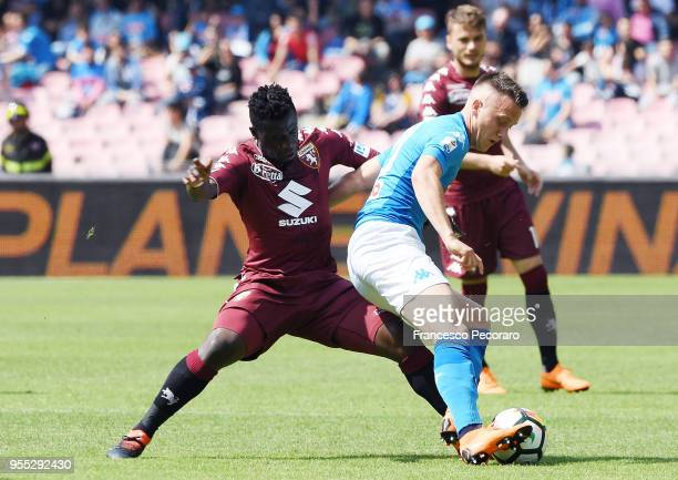 Piotr Zielinski of SSC Napoli vies with Afriyie Acquah of Torino FC during the serie A match between SSC Napoli and Torino FC at Stadio San Paolo on...