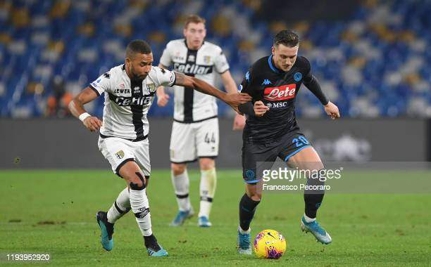 Piotr Zielinski of SSC Napoli vies with Hernani of Parma Calcio during the Serie A match between SSC Napoli and Parma Calcio at Stadio San Paolo on...