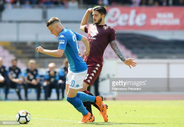 Piotr Zielinski of SSC Napoli vies with Kevin Bonifazi of Torino FC during the serie A match between SSC Napoli and Torino FC at Stadio San Paolo on...
