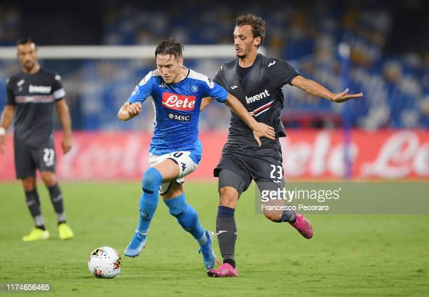 Piotr Zielinski of SSC Napoli vies with Manolo Gabbiadini of UC Sampdoria during the Serie A match between SSC Napoli and UC Sampdoria at Stadio San...