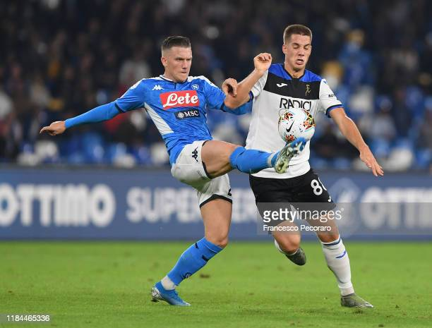 Piotr Zielinski of SSC Napoli vies with Mario Pasalic of Atalanta BC during the Serie A match between SSC Napoli and Atalanta BC at Stadio San Paolo...