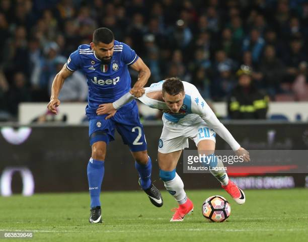 Piotr Zielinsky of Napoli competes for the ball with Tomas Rincon of Juventus during the Serie A match between SSC Napoli and Juventus FC at Stadio...