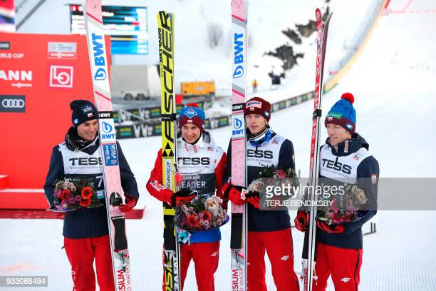 Piotr Zyla Kamil Stoch Dawid Kubacki and Stefan Hula from Poland pose after placing second the FIS World Cup RAW AIR Flying Hill Team Tournament in...