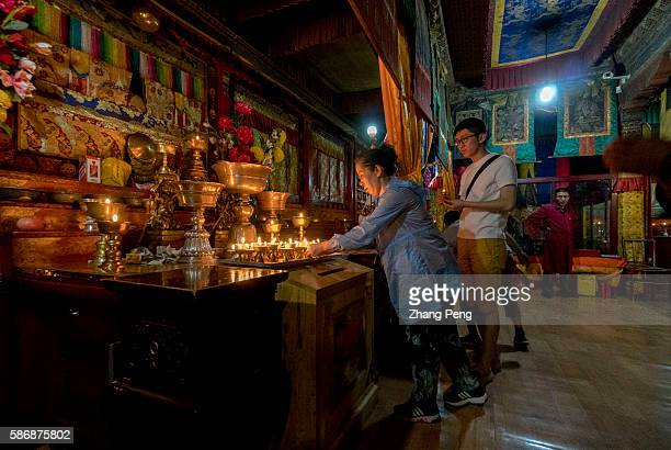 Pious pilgrims offer the butter lamps to Buddha Kumbum Monastery is one of the two most important Tibetan Buddhist monasteries outside Tibet In order...