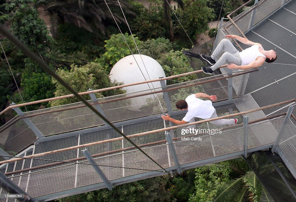 Pip Andersen professional freerunner and parkour expert runs beneath Tim Shieff as they jump down the stairs to the viewing platform below the roof of the Eden's Rainforest Biome on July 29, 2013 in St Austell, England. Pip Andersen and Tim Shieff who are both members of the pro freerunning team Storm Freerun, were at the Eden Project to help make a promotional video for the Cornish attraction. Following a record dry July, visitor numbers to the region are reported to be higher than previous years and many attractions and resorts are hoping for a busy summer season.