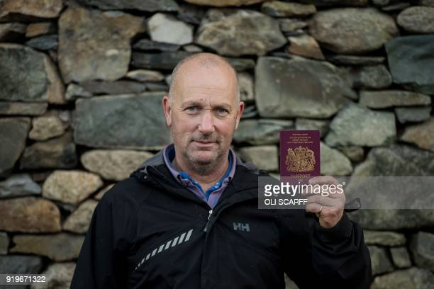 Pip Simpson a sheep farmer from Troutbeck in Westmorland poses with his British passport in his farm on Wansfell a hill in the Lake District National...