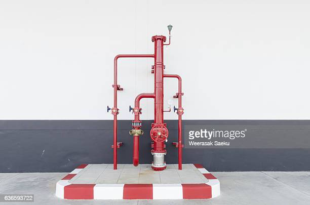 pipe and valve - red tube stock photos and pictures