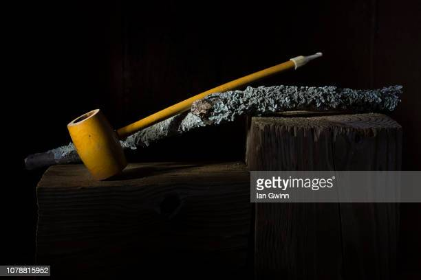 pipe and wood stick - ian gwinn stock pictures, royalty-free photos & images