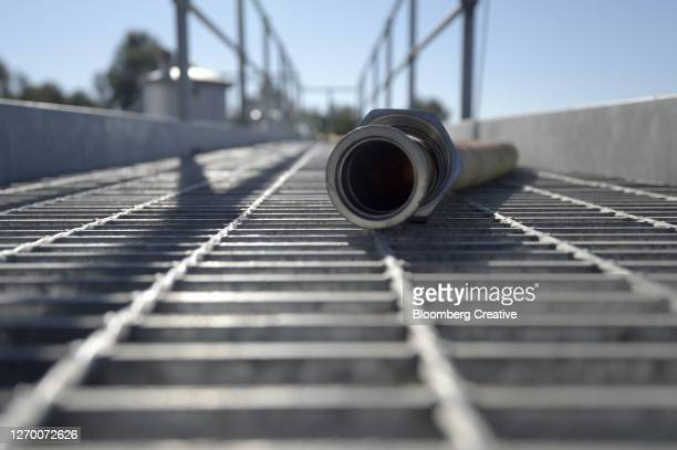 a pipe at a vineyard - industrial hose stock pictures, royalty-free photos & images