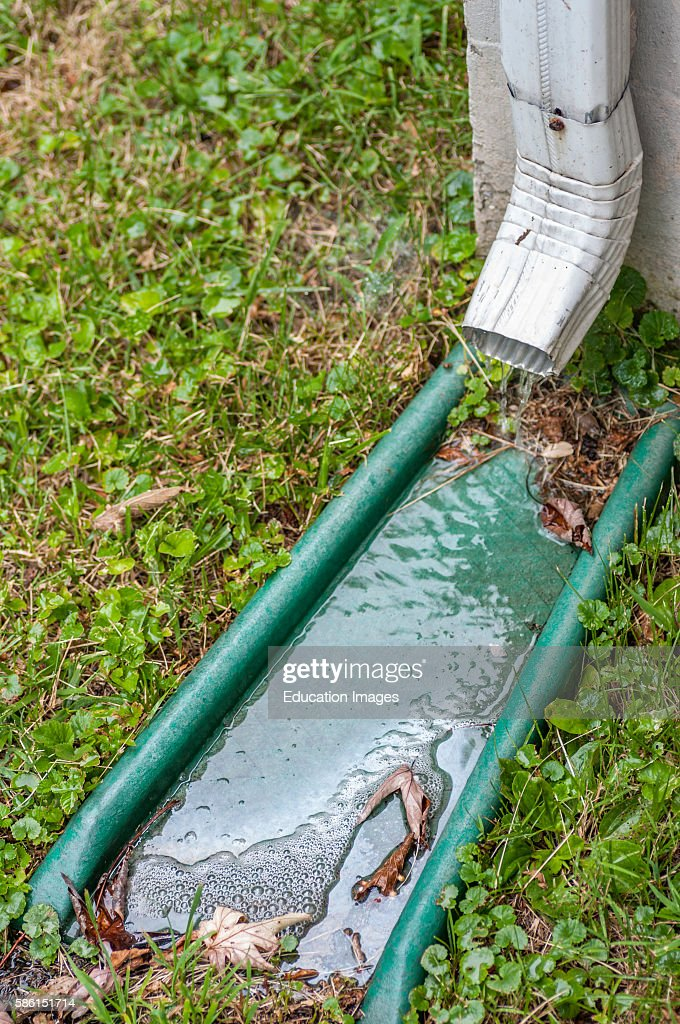 A Pipe For Carrying Rainwater From A Rain Gutters Called A