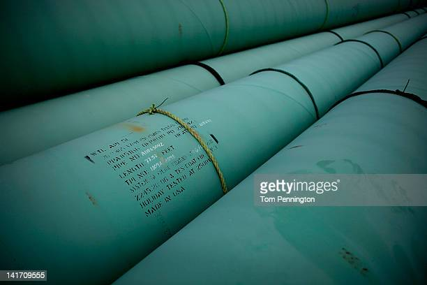 Pipe is stacked at the southern site of the Keystone XL pipeline on March 22 2012 in Cushing Oklahoma US President Barack Obama is pressing federal...