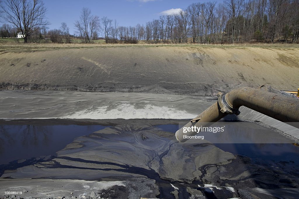 A pipe leads to a lined pit used to collect drill cuttings on a Alta Resources LLC natural gas drill rig near Montrose, Pennsylvania, U.S., on Monday, April 5, 2010. Companies are spending billions to dislodge natural gas from a band of shale-sedimentary rock called the Marcellus shale that underlies Pennsylvania, West Virginia and New York. The band of rock, so designated because it pokes through near a city of that name in northern New York, may contain 262 trillion cubic feet of recoverable gas, the U.S. Department of Energy estimates. Photographer: Daniel Acker/Bloomberg via Getty Images