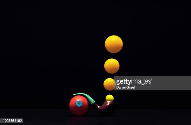 a pipe leaning on a sphere - concepts & topics stock photos and pictures