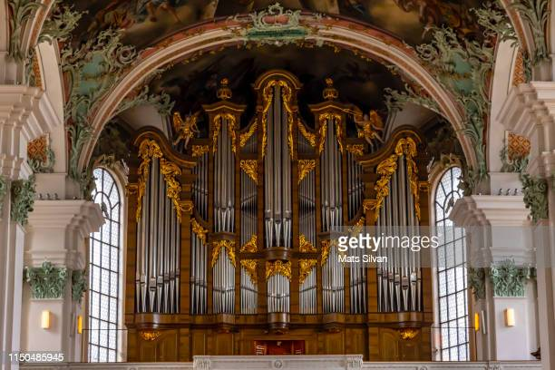 pipe organ in abbey of st gallen - church organ stock pictures, royalty-free photos & images