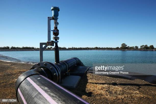A pipe runs into a holding pond at a water treatment facility