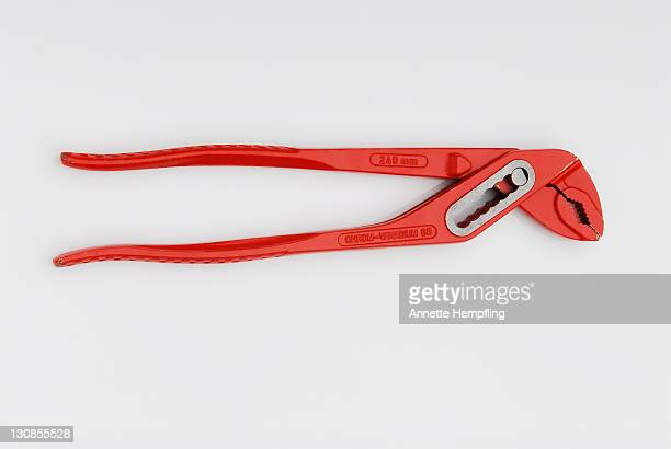 pipe wrench - red tube top stock photos and pictures