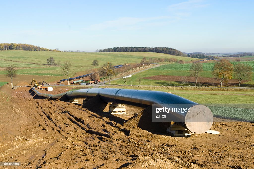 Pipeline construction in hilly landscape : Stock Photo