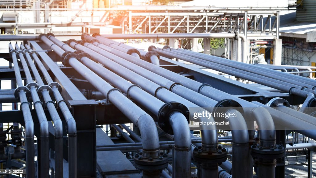 pipeline in large oil-refinery plant : Stock Photo