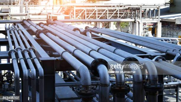 pipeline in large oil-refinery plant - pipeline stock pictures, royalty-free photos & images