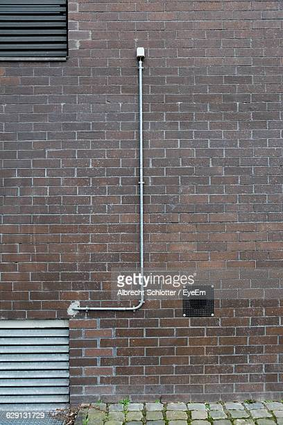 pipeline on building exterior - albrecht schlotter stock photos and pictures