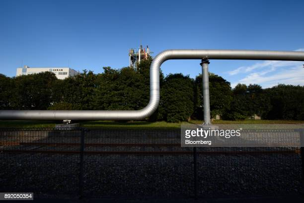 A pipeline runs along a grass verge in the Keihin industrial area in Kawasaki Kanagawa Prefecture Japan on Tuesday Dec 12 2017 The Bank of Japan will...