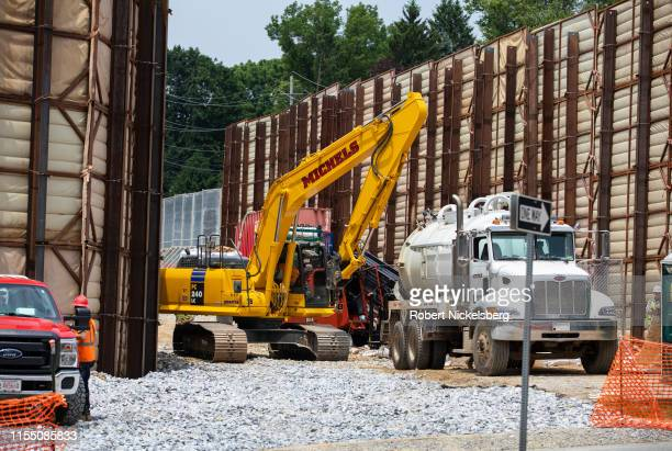Pipeliners move heavy equipment over an area where a drilling company lost electronic contact with the newly inserted 20-inch pipe for the ETP-Sunoco...