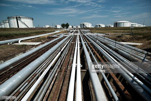 Pipelines and crude oil storage tanks stand at the Duna oil refinery operated by MOL Hungarian Oil and Gas Plc in Szazhalombatta Hungary on Tuesday...
