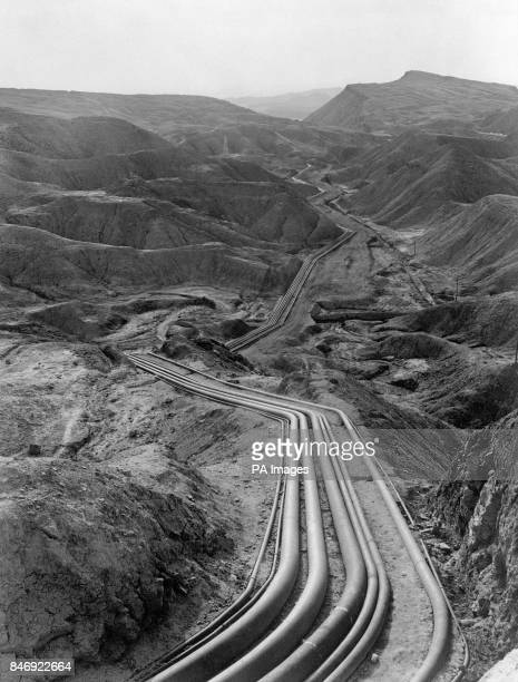 Pipelines belonging to the AngloIranian Abadan oil refinery weave through the mountainous oilfield area of Persia Iran