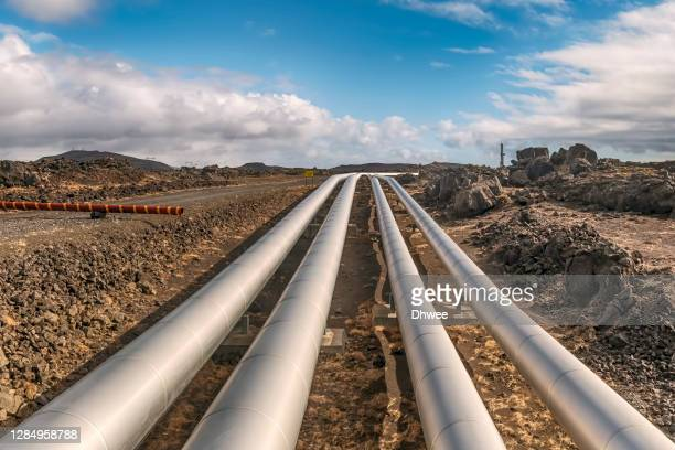 pipelines of hot water from natural hot springs in lava field area - transport stock pictures, royalty-free photos & images