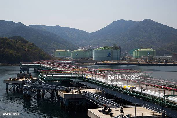 Pipelines run from the dock to liquefied natural gas storage tanks at the at the Korea Gas Corp LNG terminal in Tongyeong South Korea on Monday April...