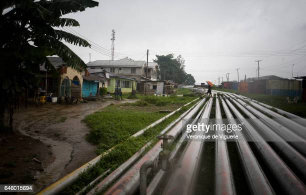 Pipelines running through the middle of Okrika village The older pipelines sometimes leak or burst The most recent incident two months ago caused...
