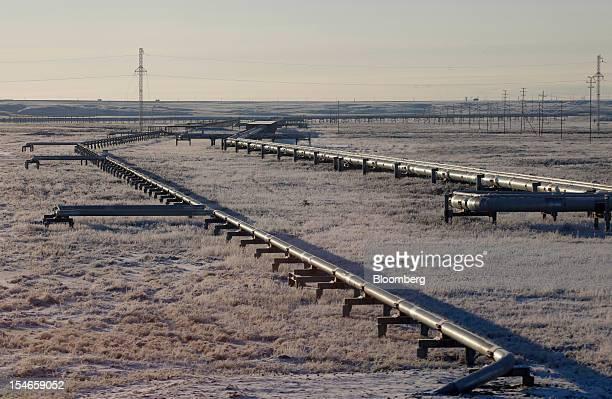 Pipelines stand in front of electricity pylons near OAO Gazprom's new Bovanenkovo deposit a natural gas field near Bovanenkovskoye on the Yamal...