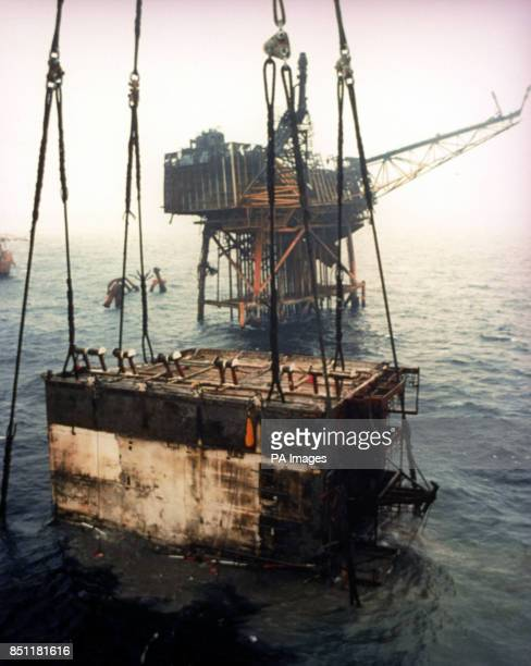 Piper Alpha's main accommodation block thought to contain the bodies of many of the 112 oilmen still unaccounted for is lifted from the North Sea...