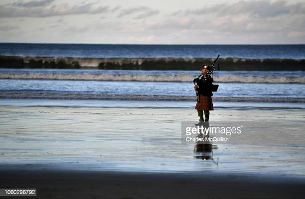 Piper Andy McGregor plays a lament as members of the public gather on Downhill beach for filmmaker Danny Boyle Pages of the Sea commissioned by 1418...