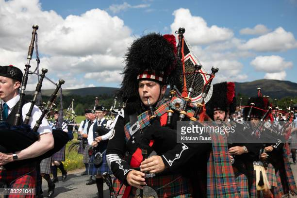 Piper band plays ahead fo the annual Highland Games 3rd of August 2019 Newtonmore Scotland United Kingdom The band is a mix of various bands from...