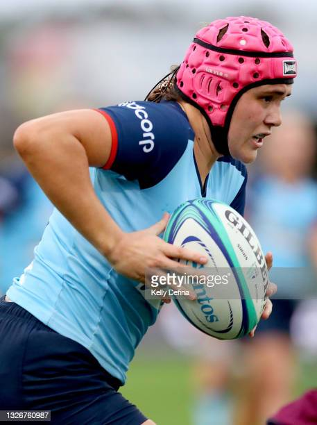 Piper Duck of the Waratahs runs with the ball during the Super W Final match between the NSW Waratahs and the Queensland Reds at Coffs Harbour...