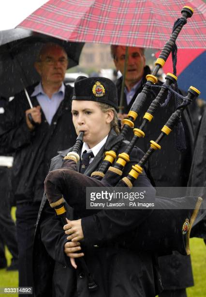 A piper from the Hamilton Police Pipeband based in Canada performs during the World Pipe Band Championships in Glasgow